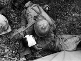 American Soldier Comforting Wounded Comrade During Fight to Take Saiapn from Japanese Troops