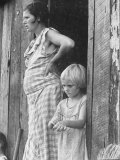 Pregnant Sharecropper's Wife Standing in Doorway of Wooden Shack with Daughter  the Depression