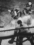 Ice Hockey Players Bill Mosienko and Max Bentley Making a Play Against the Goalie