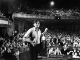 Rock Promoter Bill Graham Onstage with Audience Visible  at Fillmore East