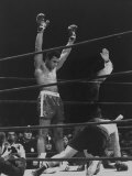 Boxer Muhammad Ali Raising His Gloves Victoriously After Knocking Out Oscar Bonavena
