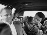 Boxer Muhammad Ali Clowning Around with His Trainer Bundini Brown