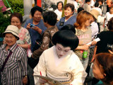 Geisha in Kimono Signing Autograph for Fan  Tokyo  Japan