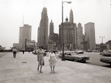 Two Ladies Walking the Sidewalk Skyscrapers in Chicago America's Windy City  in the 1960s