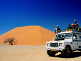 Men on Four Wheel Drive Vehicle at Dune 45 in Namib Nauklaft National Park  Sossusvlei  Namibia