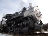 An Old Steam Engine Sits on a Siding