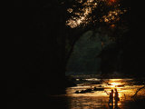 Backlit View of Couple Flyfishing on the Potomac River at Sunset