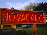 An Old Motel Sign Signals No Room at the Inn