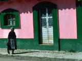 Elderly Woman Walking Past Pink and Green Building  Chiapas  Mexico