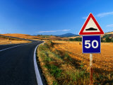 Speed Sign on Winding Road Near San Quirico d'Orica  Tuscany  Italy