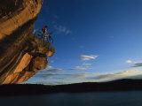 A Cyclist Atop a Rock Overhang Near Dolores  Colorado