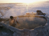 A Hiker Enjoys a Dip in a Hot Springs in Long Valley