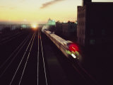 A Trans-Canada Railway Train Rushes Down the Tracks at Dusk