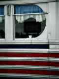 A Sign is Reflected in the Window of Local Diner