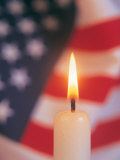 Candle with USA Flag Behind