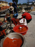 Women from Small Patou Island Grind Chilies to Powder  Dali  Yunnan  China