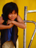 Portrait of Lao Girl at Entrance to Wat St Muang  Vientiane  Vientiane Prefecture  Laos