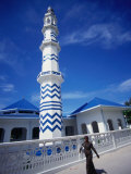 Woman Walking Past Minaret Eydhafushi  South Maalhosmadulu Atoll  Baa  Maldives