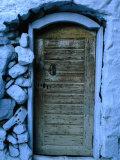 Wooden Door in Rubblestone Wall  Kalymnos  Greece