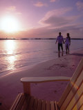 Couple Walking Along Beach at Sunset  Nassau  Bahamas  Caribbean