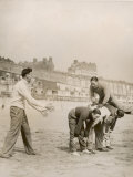 Five Men Playing Leap Frog on the Sandy Beach at Ramsgate