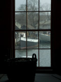 Looking Out Through a Window at Wooden Fishing Boats on a River