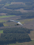 Hang-Glider Soars Over the Countryside