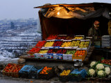 A Palestinian Fruit and Vegetable Vendor Waits for Customers