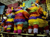 Several Brightly-Colored Pinatas Await Buyers in a Mexican Market