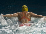 Young Woman Swimming the Butterfly Stroke in a Swimming Pool  Bainbridge Island  Washington  USA