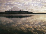 View of Snowcapped Payachata Volcano and a Cloudy Twilight Sky Mirrored in the Lake