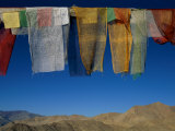 A Line of Multi-Colored Prayer Flags Sway in the Gentle Breeze in Ladakh