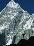 A Climber Silhouetted against Mountains in the Karakoram Range