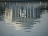 A Serene Reflection of the Jefferson Memorial in the Tidal Basin