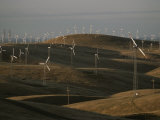 Rows of Windmills on Open Hills Produce Alternative Sources of Energy