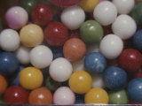 Close View of Colorful Gumballs in a Vending Machine