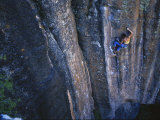 A Young Woman Climbs a Wall in Moab  Utah