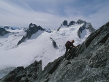A Climber Ascends Bugaboo Spire with Howser Towers in the Distance