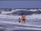 A Man and Child Play in the Assateague Island Surf