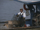 Smiling Fisherman on a Crab Boat