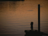 Lovers in an Embrace at Sunset on a Pier over Victoria Harbour