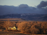 Early Morning Sun Warms a Rural Landcape Near Augusta  the Rocky Mountains Loom in the Distance