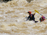 Kayakers Paddle in Colorado River Rapids