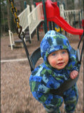 Baby on a Swing at a Playground