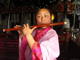 The Musician is Playing a Chinese Flute at the Temple of Eternal