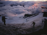 Dawn's Light Finds Mountaineers Crossing a Snow-Crusted Ridge of Mt Hood  Oregon