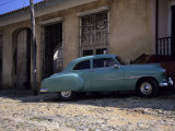 An Old American Car Sits in Front of a House  Trinidad  Cuba