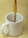 A Cup of Energy Filled Coffee is Poured into a Mug