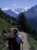 A Hiker Enjoys the View of the Glacier from the Alpine Trail  Morteratsch Glacier  Switzerland