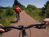 Two Bikers Enjoy a Summer Ride Along a Trail  Charlottetown  Prince Edward Island  Canada
